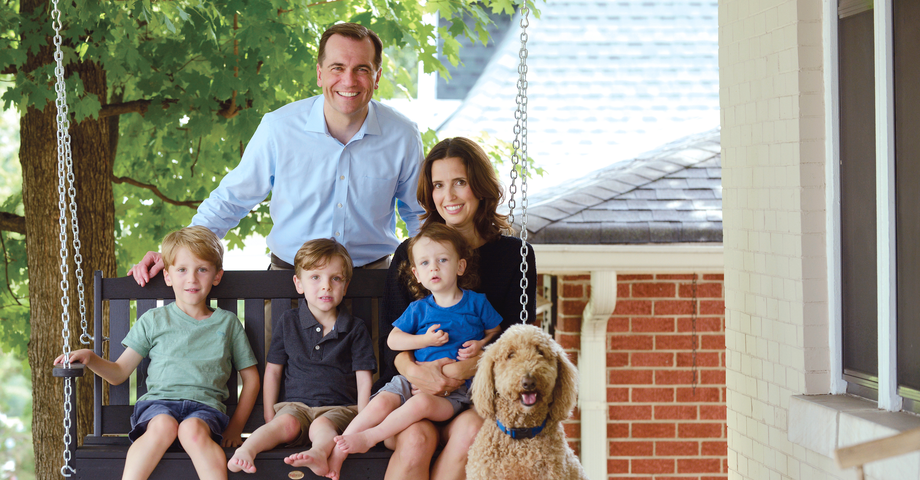 Portrait of John Ray Clemmons & his family on their front porch.